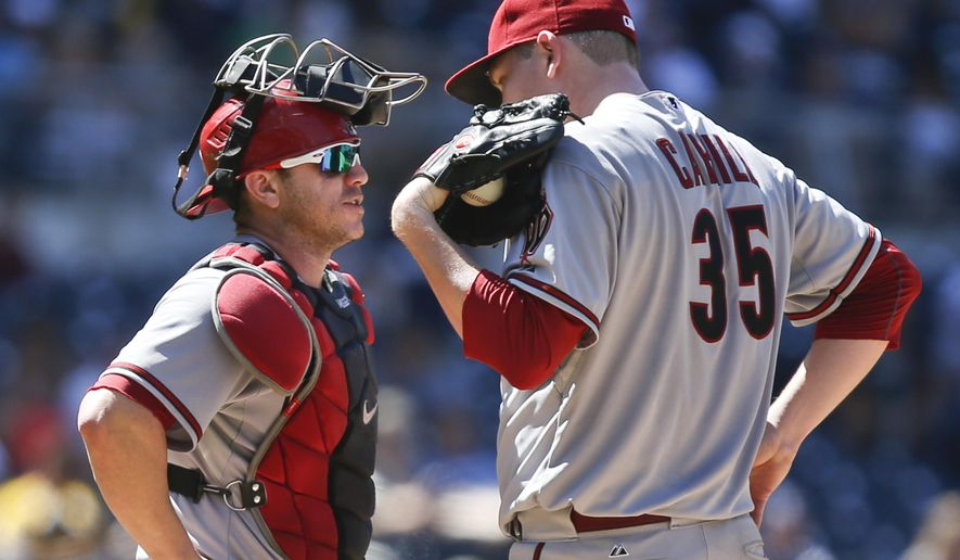 Arizona Diamondbacks starting pitcher Trevor Cahill and catcher Miguel Montero have meeting during a bases loaded jam against the San Diego Padres in the fourth inning of a baseball game Monday, Sept. 1, 2014, in San Diego.  (AP Photo/Lenny Ignelzi)