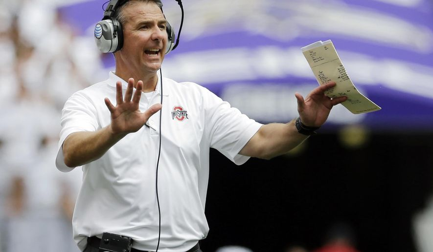 Ohio State head coach Urban Meyer directs his players in the second half of an NCAA college football game against Navy in Baltimore, Saturday, Aug. 30, 2014. Ohio State won 34-17. (AP Photo/Patrick Semansky)