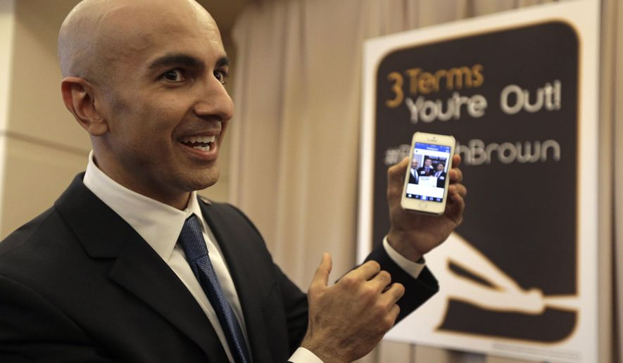 FILE -- In this March 14, 2014 file photo, Gubernatorial candidate Neel Kashkari displays a campaign video posted to Instagram at the California Republican Party 2014 Spring Convention in Burlingame, Calif. Kashkari, a former U.S. Treasury official who has never held elective office, is challenging incumbent Gov. Jerry Brown in the November election.(AP Photo/Ben Margot, file)