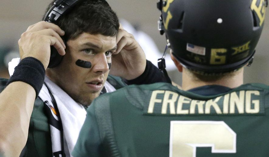 Baylor quarterback Bryce Petty adjusts his head set while standing on the sideline during the second half of an NCAA college football game against SMU Sunday, Aug. 31, 2014, in Waco, Texas. Despite only playing two quarters, Petty threw for two touchdowns and ran for another score, helping No. 10 Baylor open its riverfront campus stadium with a 45-0 victory over former Southwest Conference rival SMU. (AP Photo/LM Otero)