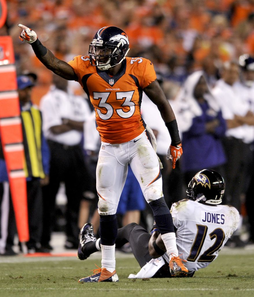Denver Broncos safety Duke Ihenacho (33) celebrates his tackle of Baltimore Ravens wide receiver Jacoby Jones (12) during the first half of an NFL football game, Thursday, Sept. 5, 2013, in Denver. (AP Photo/Jack Dempsey)