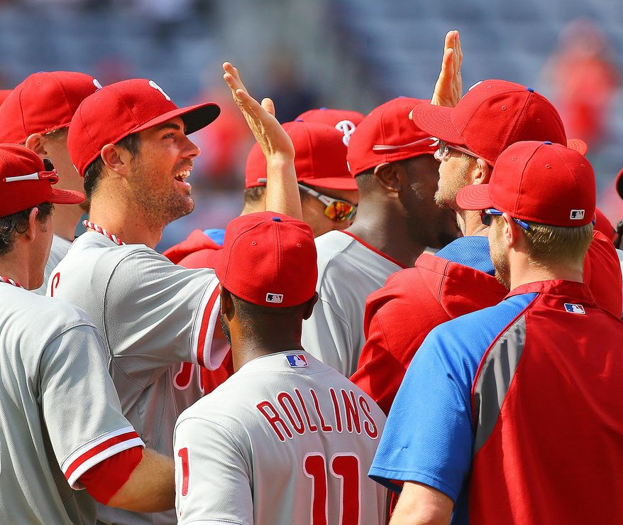 Philadelphia Phillies Cole Hamels,left, and teammates celebrate a 7-0 no hitter against the Atlanta Braves in a baseball game in Atlanta on Monday, Sept. 1, 2014. Hamels went six innings and relievers Jake Diekman, Ken Giles and closer Jonathan Papelbon combined to no-hit the Braves.  i   (AP Photo/Atlanta Journal-Constitution, Curtis Compton)  MARIETTA DAILY OUT; GWINNETT DAILY POST OUT; LOCAL TELEVISION OUT; WXIA-TV OUT; WGCL-TV OUT