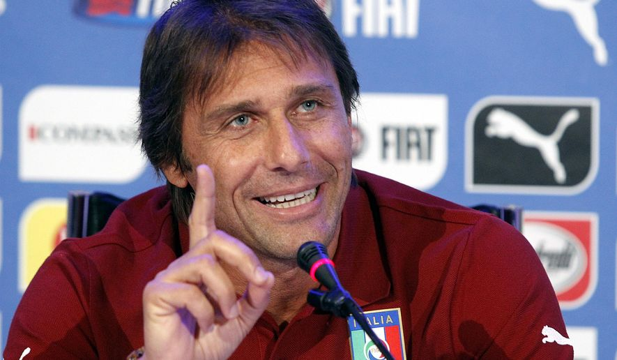 New Italy soccer team coach Antonio Conte answers a reporter's question during a media conference following a training session at Coverciano sports grounds, near Florence, Italy, Monday, Sept. 1, 2014. Italy is scheduled to play the Netherlands in a friendly soccer match in Bari, Italy, on Thursday. (AP Photo/Fabrizio Giovannozzi)
