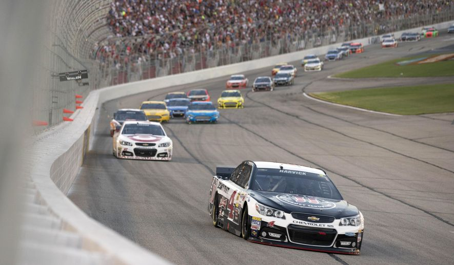 Sprint Cup Series driver Kevin Harvick (4) leads the field into the first turn after the start of the  NASCAR Sprint Cup auto race at Atlanta Motor Speedway Sunday, Aug. 31, 2014, in Hampton, Ga..  (AP Photo/John Bazemore)