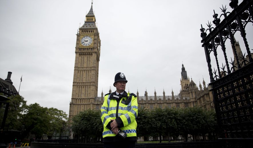 British cops outsource criminal investigations tell some victims to a british police officer stands guard outside the houses of parliament in london monday solutioingenieria Image collections