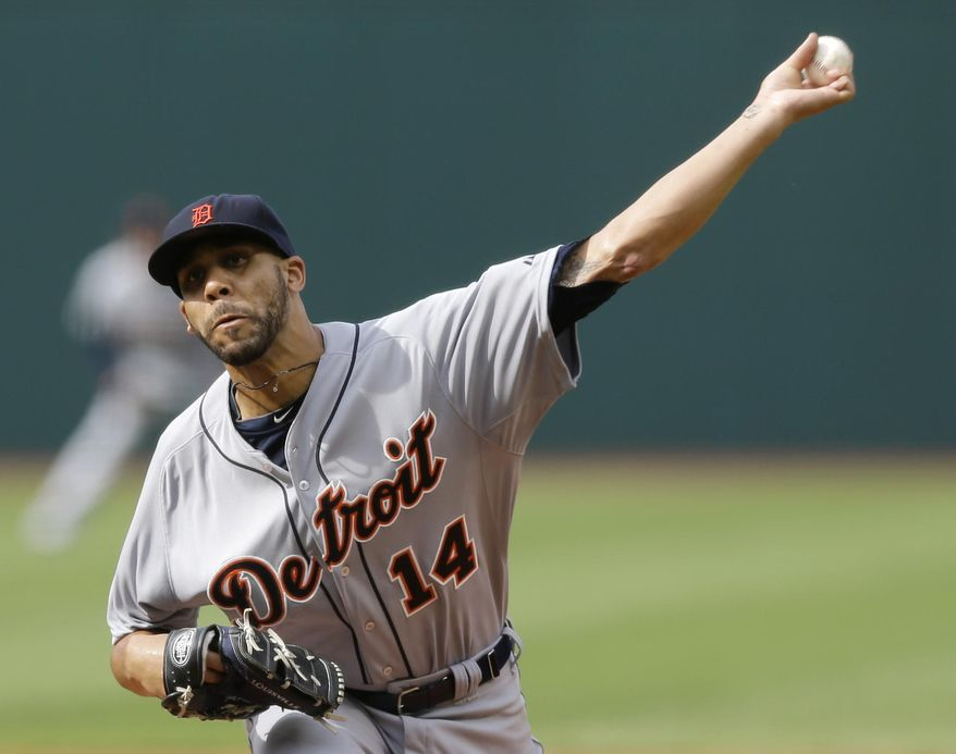 Detroit Tigers starting pitcher David Price delivers in the first inning of a baseball game against the Cleveland Indians, Monday, Sept. 1, 2014, in Cleveland. (AP Photo/Tony Dejak)