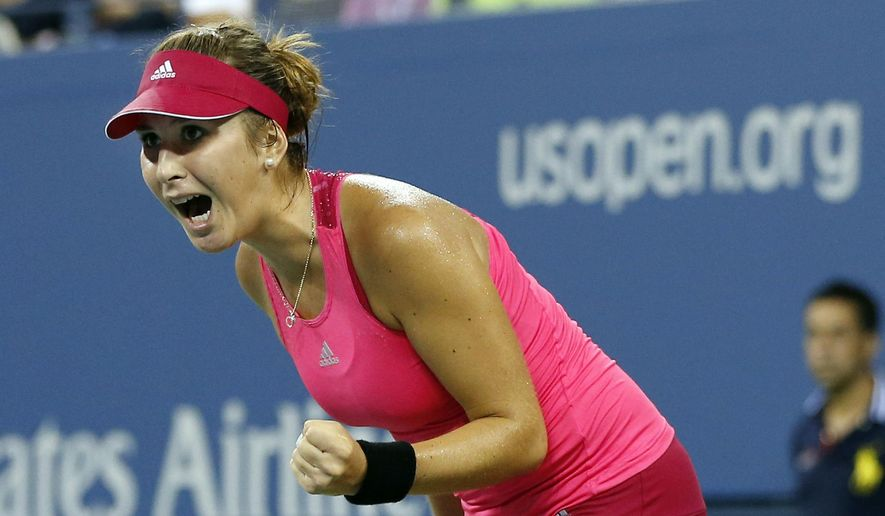 Belinda Bencic, of Switzerland, reacts on her way to her upset victory over Jelena Jankovic, of Serbia, in the fourth round of the 2014 U.S. Open tennis tournament, Sunday, Aug. 31, 2014, in New York. Bencic won 7-6 (6), 6-3. (AP Photo/Elise Amendola)