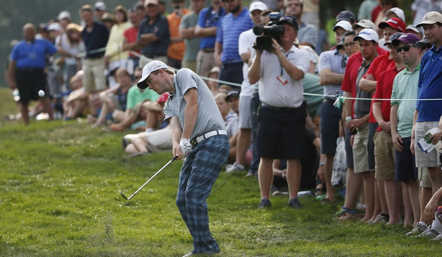 Russell Henley hits out of the rough on the 18th hole during the third round of the Deutsche Bank Championship golf tournament in Norton, Mass., Sunday, Aug. 31, 2014. (AP Photo/Michael Dwyer)