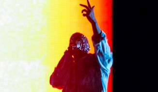 Kanye West performs on stage during the Made In America Festival at Grand Park on Sunday, Aug. 31, 2014, in Los Angeles. (Photo by Paul A. Hebert/Invision/AP)