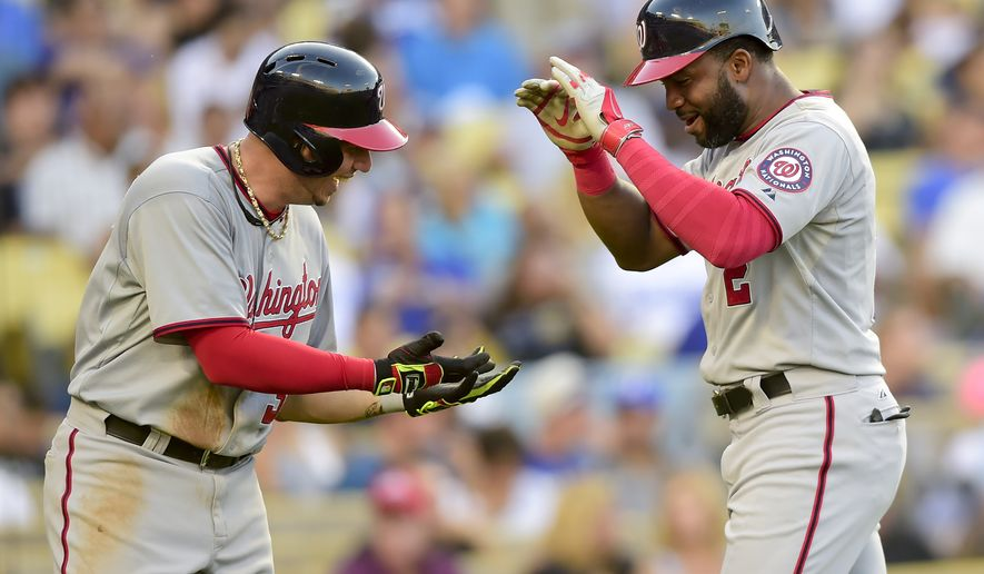 Washington Nationals Asdrubal Cabrera, left, celebrates teammate Denard Span's (2) two run home run allowing them both to score in the fifth inning of a baseball game against the Los Angeles Dodgers, Monday, Sept. 1, 2014, in Los Angeles. (AP Photo/Gus Ruelas)
