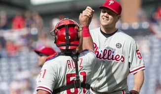 Philadelphia Phillies relief pitcher Jonathan Papelbon (58) celebrates with catcher Carlos Ruiz (51) after getting the final out in the ninth inning of a baseball game against the Atlanta Braves Monday, Sept. 1, 2014, in Atlanta. Papelbon combined with Cole Hamels, Ken Giles, and Jake Diekman for a no hitter. (AP Photo/John Bazemore)