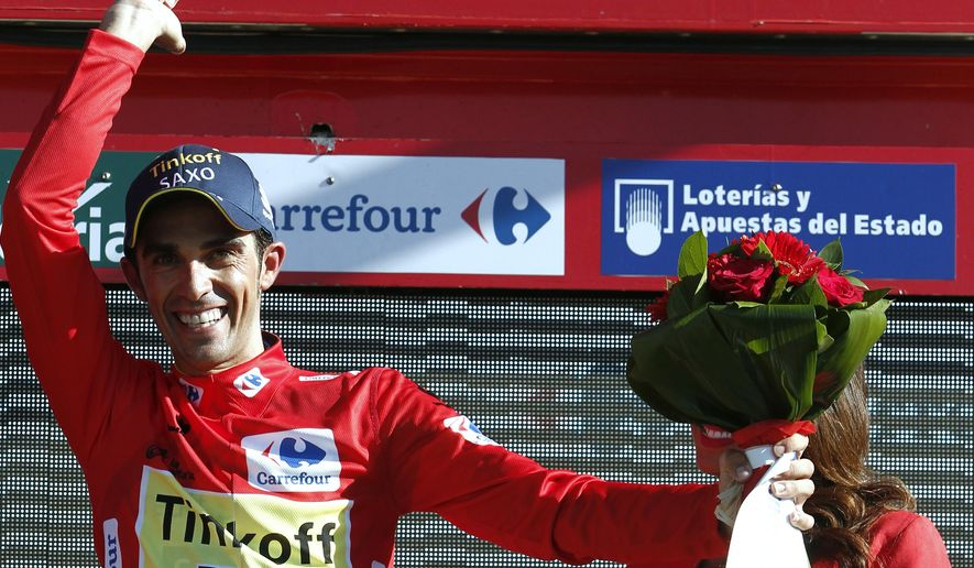 Spain's Alberto Contador, the new leader of Spain Vuelta Cycling, receives on the podium the overall leader after winning the 36,7 kilometers (22-mile) time trial, Real Monasterio Santa Maria de Varuela-Borja, the 10th stage of the Spanish Vuelta cycling race,  in Borja, Spain, Tuesday Sept. 2, 2014. (AP Photo/Ivan Aguinaga)