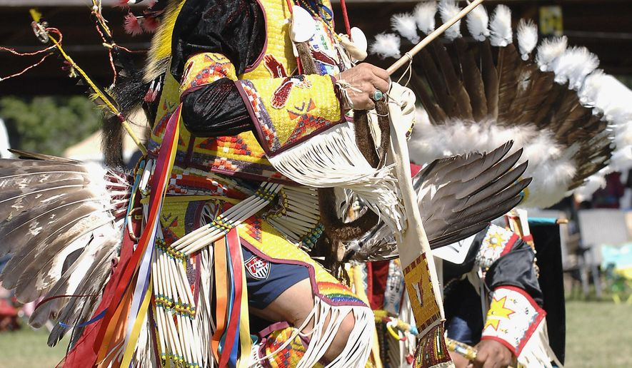 FILE - In this Sept. 9, 2011 file photo, Jim Red Eagle dances at the annual United Tribes International Powwow in Bismarck, N.D. Tribal leaders in the Dakotas  are meeting at the 18th annual Tribal Leaders Summit  beginning Wednesday, Sept. 3, 2014, in Bismarck to discuss topics ranging from health care to economic development. The summit coincides with the United Tribes International Powwow that runs Thursday through Sunday.  (AP Photo/The Bismarck Tribune, Will Kincaid, File)
