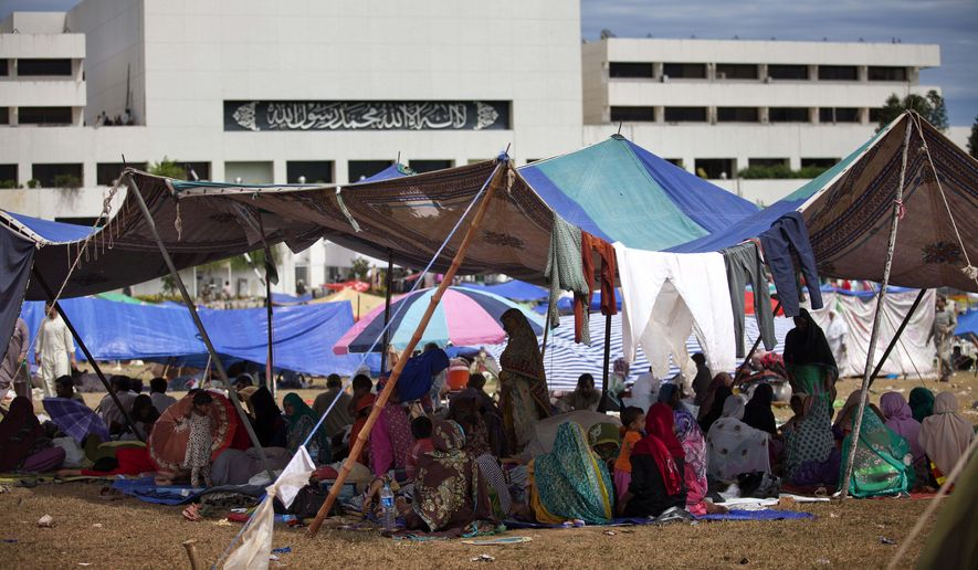 Supporters of Muslim cleric Tahir-ul-Qadri camp inside the vicinity of the parliament building in Islamabad, Pakistan, Tuesday, Sept. 2, 2014. Pakistan's lawmakers held an emergency session Tuesday over the political crisis roiling the country as thousands of anti-government protesters remained camped out in front of the parliament building, demanding Prime Minister Nawaz Sharif resign. (AP Photo/B.K. Bangash)
