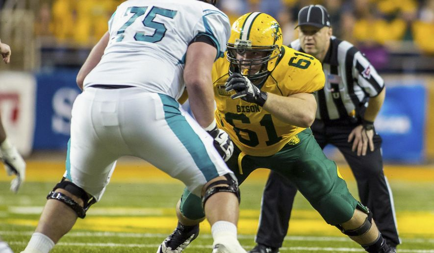 The Dec. 14, 2013 photo provided by the North Dakota State Athletics Department shows North Dakota State nose guard Brian Schaetz (61) in action during a playoff game against Coastal Carolina at the Fargodome in Fargo, N.D.  Coaches singled out Schaetz for his play in a 34-14 win over Iowa State on Saturday, Aug. 30, 2014. (AP Photo/Courtesy of the North Dakota State Athletics Department, Tyler Ingham)