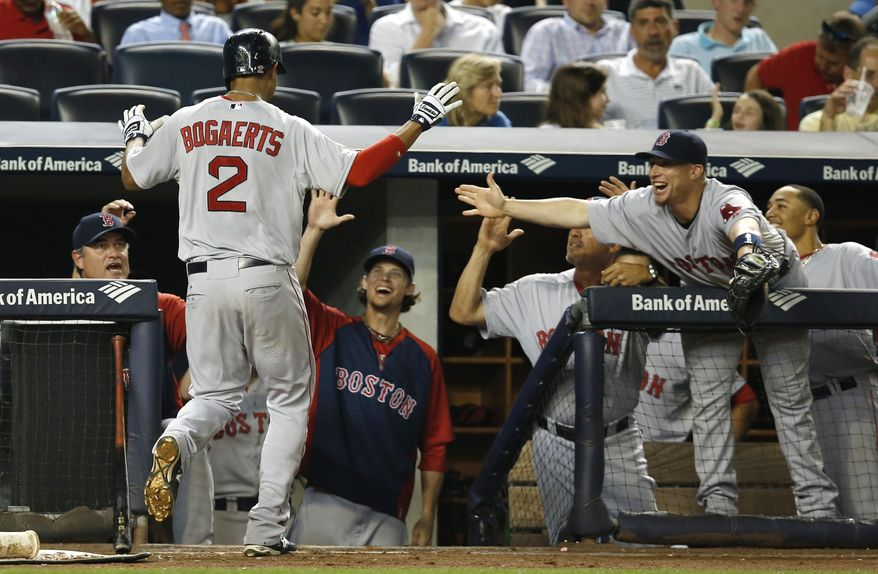 Boston Red Sox's Xander Bogaerts (2) is greeted at the dugout steps after his third-inning solo home run off New York Yankees starting pitcher Shane Greene, moments after Boston's Daniel Nava hit a three-run home run off Greene, in a baseball game at Yankee Stadium in New York, Tuesday, Sept. 2, 2014. Greene was pulled after the back-to-back homers. (AP Photo/Kathy Willens)