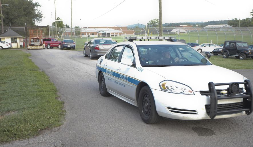 A Nashville police car leaves the Woodland Hills Youth Development Center Tuesday, Sept. 2, 2014, in Nashville, Tenn. Thirty-two teens escaped from a Nashville youth detention center by crawling through a weak spot in a fence late Monday, and more than half of them were still on the run Tuesday, a spokesman said.  (AP Photo/Mark Humphrey)