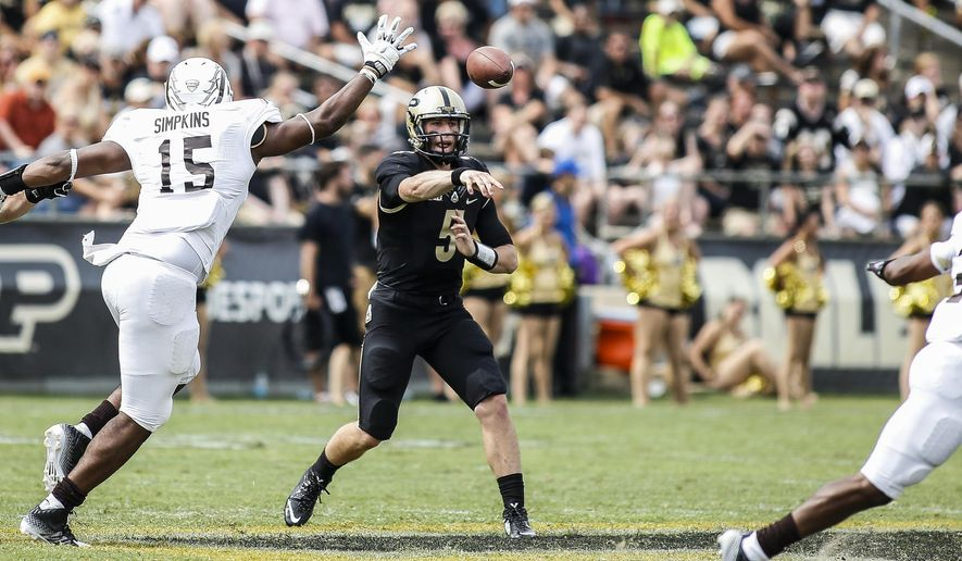 Purdue's quarterback Danny Etling (5) tries to throw a pass  over Western Michigan's defense lineman Jamar Simpkins (15) during an NCAA college football game Saturday, Aug. 30, 2014, in West Lafayette, Ind. Purdue won 43-34. (AP Photo/Kalamazoo Gazette-MLive Media Group, Junfu Han) ALL LOCAL TELEVISION OUT; LOCAL TELEVISION INTERNET OUT