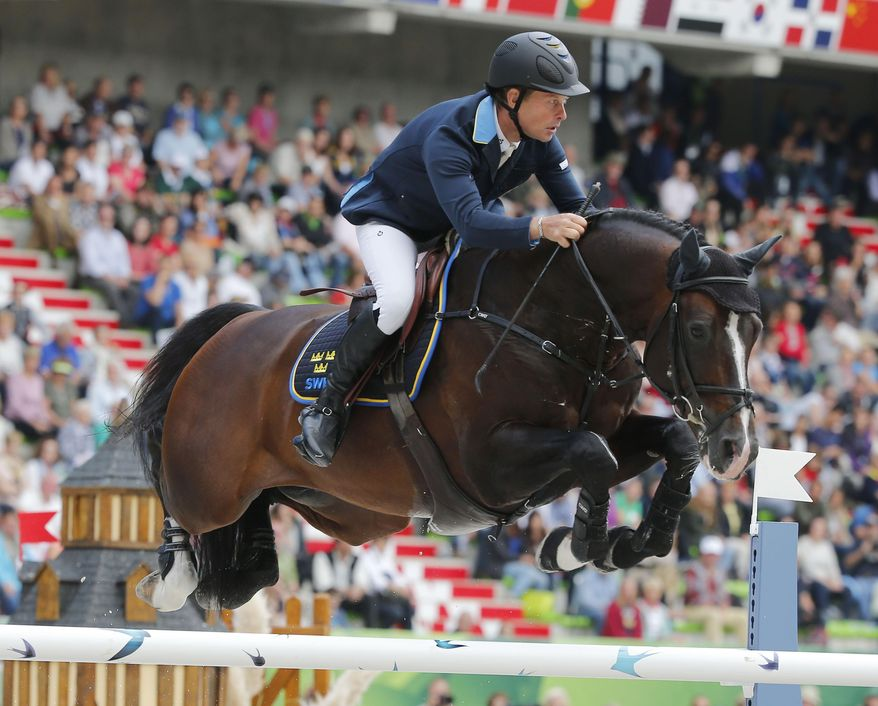 Rolf-Goeran Bengtsson of Sweden, riding Casall Ask during the team and individual qualifying show jumping event at the FEI World Equestrian Games in Caen, western France, Tuesday, Sept. 2, 2014. Bertram Allen of Ireland heads in the individual competition in front of Patrice Delaveau of France and Gregory Wathelet of Belgium. In the team competition France is ahead of Sweden and the United States.  (AP Photo/Michel Euler)