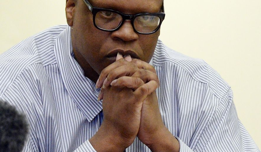 Leon Brown listens to evidence during a court hearing for him and his brother, death row inmate Henry McCollum Tuesday, Sept. 2, 2014 in Lumberton, N.C. On Tuesday, a judge overturned the convictions of Henry McCollum, 50, and Leon Brown, 46, in the 1983 rape and murder of the 11-year-old girl, citing the new evidence that they are innocent. The ruling is the latest twist in a notorious legal case against the men that began with what defense attorneys said were coerced confessions from two scared teenagers with low IQs. (AP Photo/The News & Observer, Chuck Liddy)