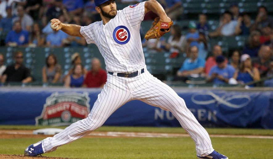 Chicago Cubs starting pitcher Jake Arrieta delivers during the first inning of a baseball game against the Milwaukee Brewers, Tuesday, Sept. 2, 2014, in Chicago. (AP Photo/Charles Rex Arbogast)