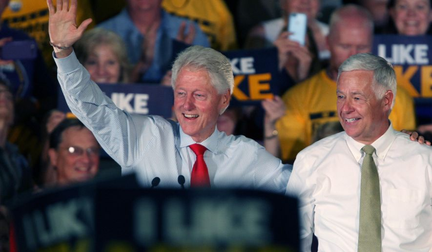 Former President Bill Clinton, joined by Rep. Mike Michaud, D-Maine, greet supporters at a campaign rally for Michaud's campaign for governor, Tuesday, Sept. 2, 2014 in Portland, Maine. (AP Photo/Joel Page)