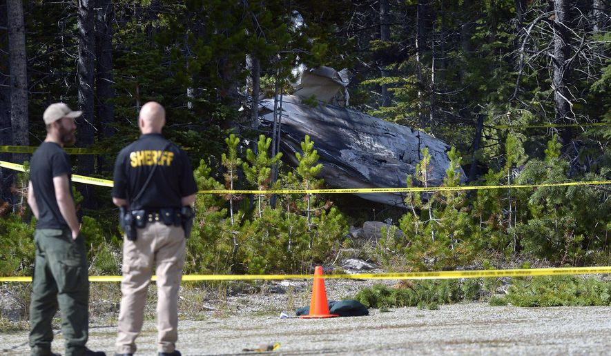 The wreckage of a small plane crash is visible from the parking lot of the Silver Crest Ski Area near Kings Hill on Tuesday afternoon, Sept. 2, 2014 in Great Falls, Mont.  There was one confirmed fatality and at least one other occupant who was rushed to Great Falls for medical treatment. (AP Photo/The Great Falls Tribune, Rion Sanders)  NO SALES