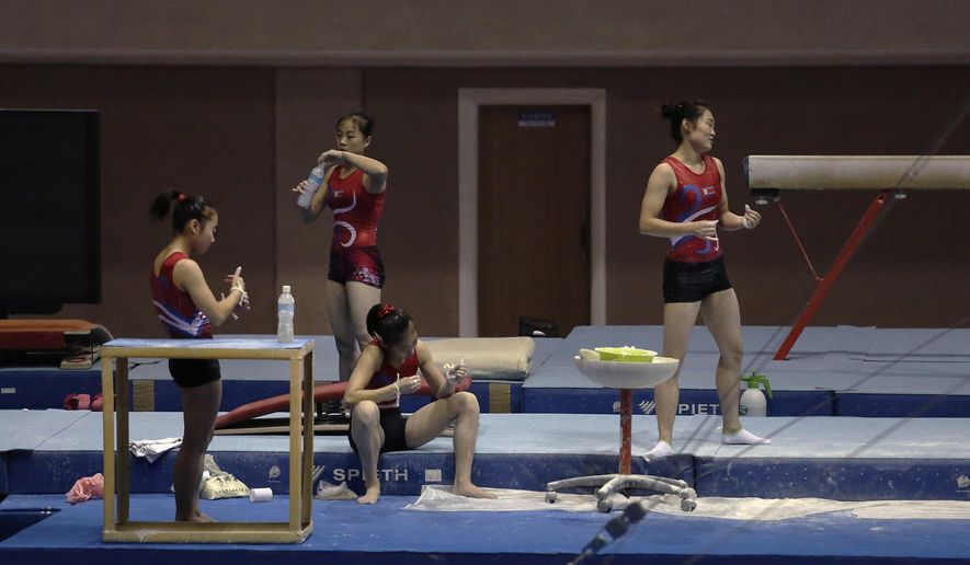 Athletes from a local gymnastics team break from training, Tuesday, Sept. 2, 2014 in Pyongyang, North Korea. In just over a week, North Korea will send its top athletes to win gold for their leader in what could well be the biggest sporting event of their lives and a major propaganda campaign for their nation, the Asian Games in Incheon, South Korea.(AP Photo/Wong Maye-E)