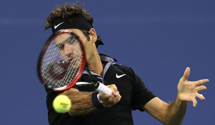 Roger Federer, of Switzerland, returns against Roberto Bautista Agut, of Spain, during the fourth round of the 2014 U.S. Open tennis tournament, Tuesday, Sept. 2, 2014, in New York. (AP Photo/Charles Krupa)