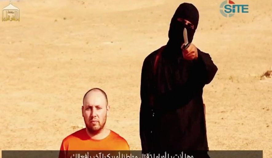 Sacrificed: An image taken from a video released by the SITE Intelligence Group shows American journalist Steven Joel Sotloff, 31, just before his execution. (SITE Intelligence Group via Associated Press)