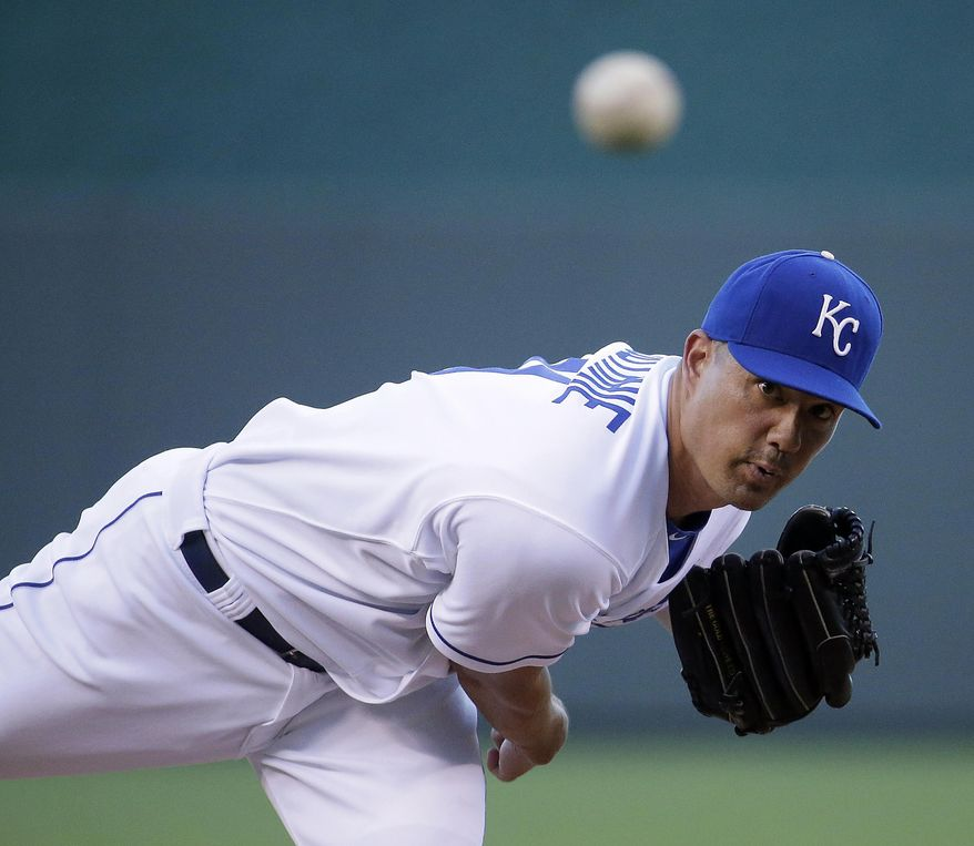 Kansas City Royals starting pitcher Jeremy Guthrie throws during the first inning of a baseball game against the Texas Rangers, Tuesday, Sept. 2, 2014, in Kansas City, Mo. (AP Photo/Charlie Riedel)