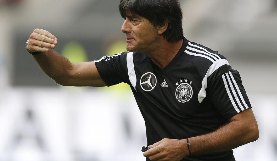 Gemany's head coach Joachim Loew gestures during an open training session ahead of the friendly soccer match between Germany and Argentina on Wednesday in Duesseldorf, Germany, Monday, Sept. 1, 2014. (AP Photo/Frank Augstein)