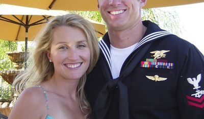 This undated photo provided by the Vaughn family shows Aaron Vaughn, right, and his wife Kimberly of Virginia Beach, Va. Aaron Vaughn, a 30-year-old father of two, was among the Navy SEALs killed Saturday when a rocket-propelled grenade fired by a Taliban insurgent downed their Chinook helicopter en route to a combat mission. (AP Photo/Vaughn Family)