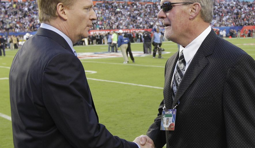FILE - In this Feb. 7, 2010, file photo, NFL Commissioner Roger Goodell, left, shakes hands with Indianapolis Colts owner Jim Irsay before the start of the NFL Super Bowl XLIV football game between the Colts and New Orleans Saints in Miami. The NFL suspends Irsay for six games and fines him a maximum $500,000 after he pleads guility to a misdemeanor in a drug case stemming from a March traffic stop. Commissioner Goodell says owners must be held to a higher standard than players. (AP Photo/David J. Phillip, File)