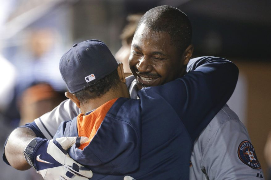 FILe - In this Aug. 19, 2014, file photo, Houston Astros' Chris Carter celebrates with teammates after hitting a three-run home run during the ninth inning of a baseball game against the New York Yankees in New York. Carter hit a major league-leading 12 home runs last month to move past early season struggles and put him in position to become one of the most anonymous players in years to win the home run title.  (AP Photo/Frank Franklin II, File)