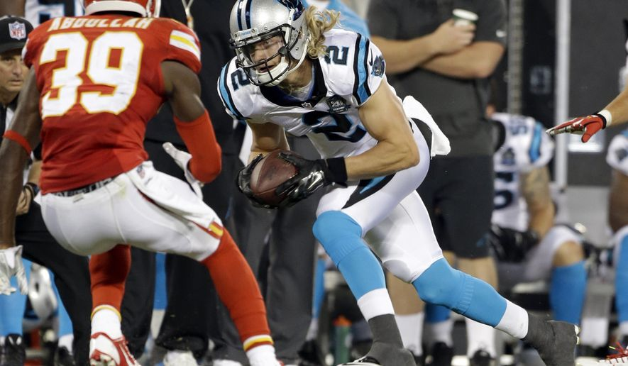 FILE - In this Aug. 17, 2014, file photo, Carolina Panthers' Brenton Bersin (2) runs after a catch as Kansas City Chiefs' Husain Abdullah (39) defends during the first half of a preseason NFL football game in Charlotte, N.C., Sunday, Aug. 17, 2014. Bersin is the first Wofford player to make an NFL roster since the man who employs him _ Panthers team owner Jerry Richardson. (AP Photo/Bob Leverone, File)
