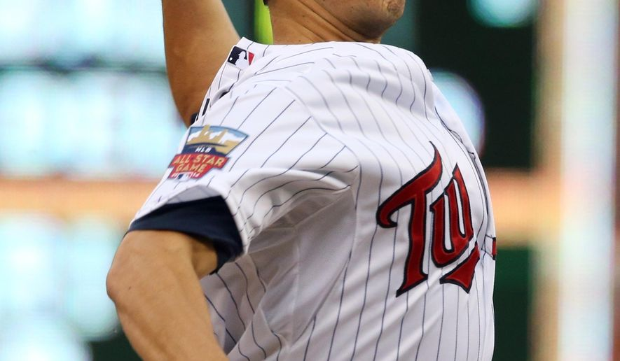 Minnesota Twins pitcher Tommy Milone throws against the Chicago White Sox in the first inning of a baseball game, Tuesday, Sept. 2, 2014, in Minneapolis. (AP Photo/Jim Mone)