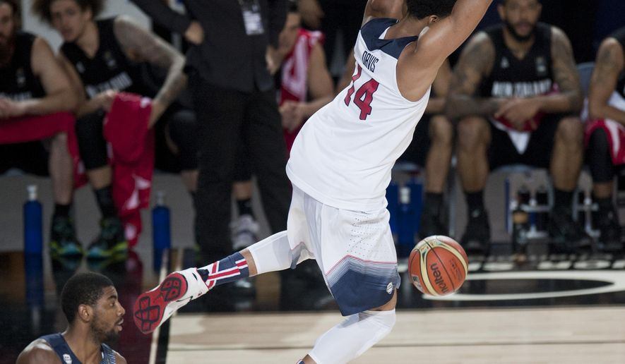 Anthony Davis of the US dunks the ball during their Group C Basketball World Cup match against New Zealand in Bilbao, northern Spain, Tuesday Sept. 2, 2014. The 2014 Basketball World Cup competition takes place in various cities in Spain from Aug. 30 through to Sept. 14. (AP Photo/Alvaro Barrientos)