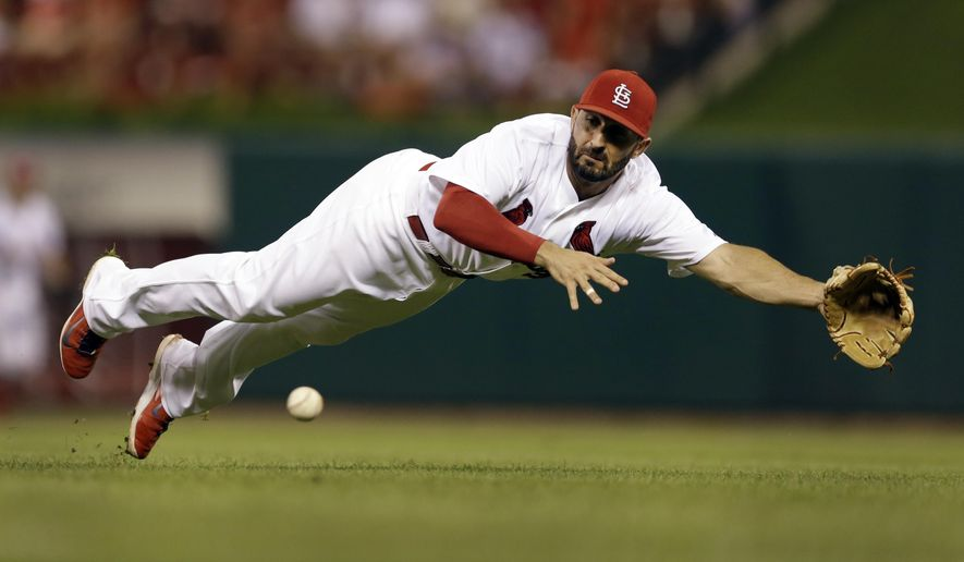 St. Louis Cardinals second baseman Daniel Descalso cannot reach a ball hit for a single by Pittsburgh Pirates' Ike Davis during the fourth inning of a baseball game Tuesday, Sept. 2, 2014, in St. Louis. (AP Photo/Jeff Roberson)