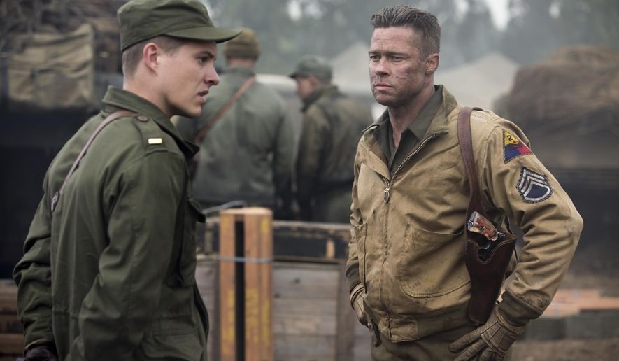 """This image released by Columbia Pictures shows Brad Pitt, right, and Xavier Samuel in a scene from """"Fury."""" (AP Photo/Columbia Pictures - Sony, Giles Keyte)"""