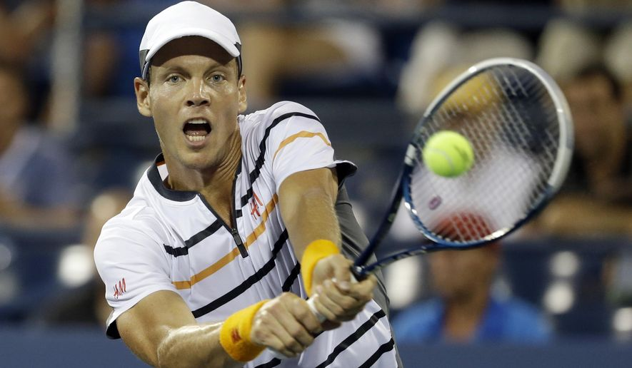 Tomas Berdych, of the Czech Republic, returns a shot to Dominic Thiem, of Austria, during the fourth round of the 2014 U.S. Open tennis tournament Tuesday, Sept. 2, 2014, in New York. (AP Photo/Darron Cummings)