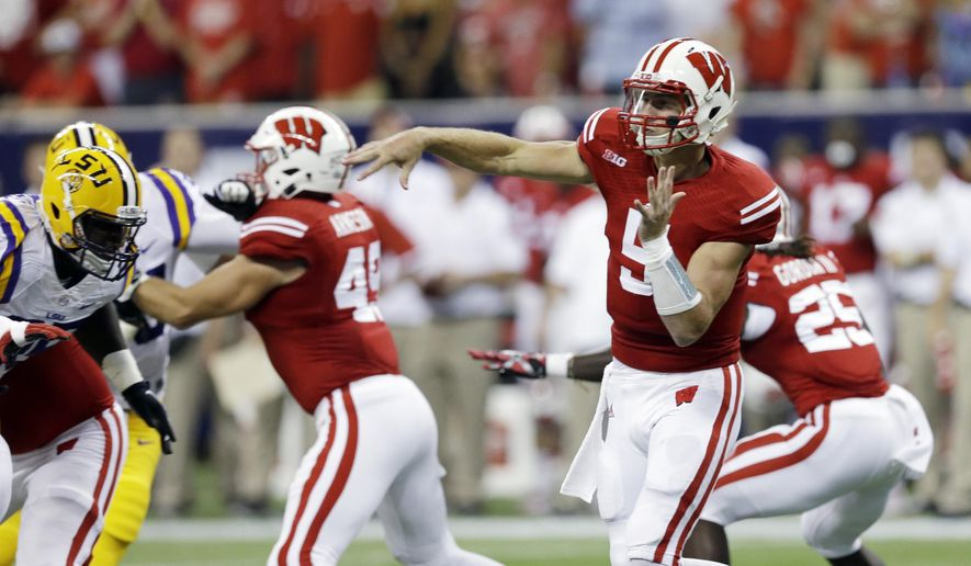 Wisconsin's Tanner McEvoy throws during the first half of an NCAA college football game against LSU Saturday, Aug. 30, 2014, in Houston. (AP Photo/David J. Phillip)