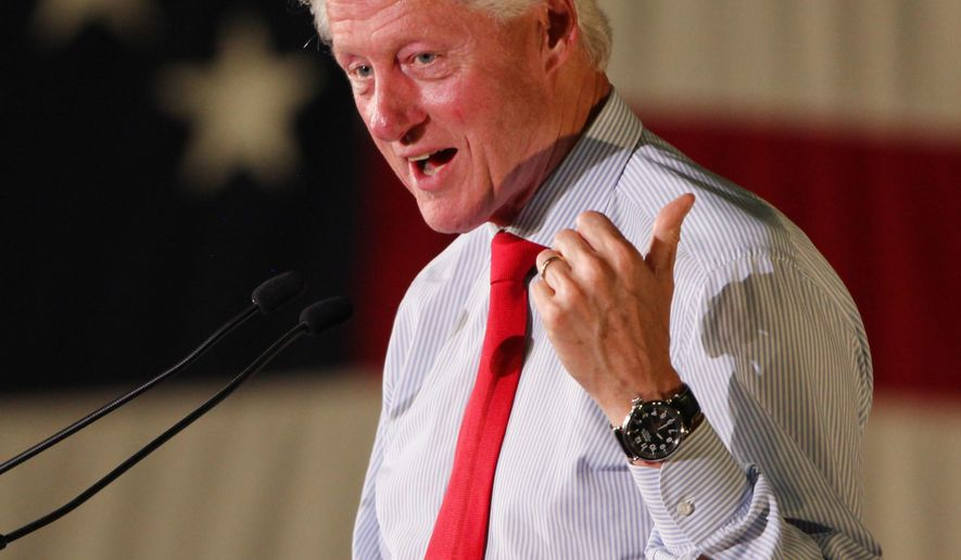 Former President Bill Clinton speaks, Tuesday, Sept. 2, 2014 in Portland, Maine at a campaign rally for Rep. Mike Michaud's campaign for governor. (AP Photo/Joel Page)