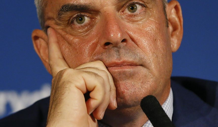 European Ryder cup team captain Paul McGinley listens during a press conference at Wentworth Golf Club to announce his three wild card selections for his team to play at Gleneagles in Scotland against the USA, in Wentworth England, Tuesday, Sept. 2, 2014. (AP Photo/Kirsty Wigglesworth)