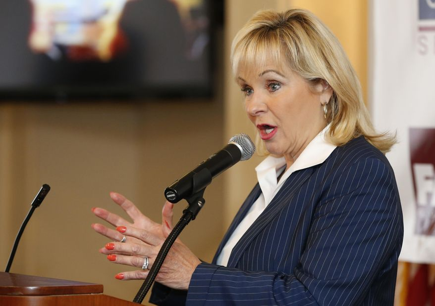 Oklahoma Governor Mary Fallin gestures as she speaks during a Republican rally in Edmond, Okla, Tuesday, Sept. 2, 2014. Fallin, who is in an increasingly tight race for re-election, is partnering with other popular Republican politicians as she hits the campaign trail ahead of the November election. (AP Photo/Sue Ogrocki)