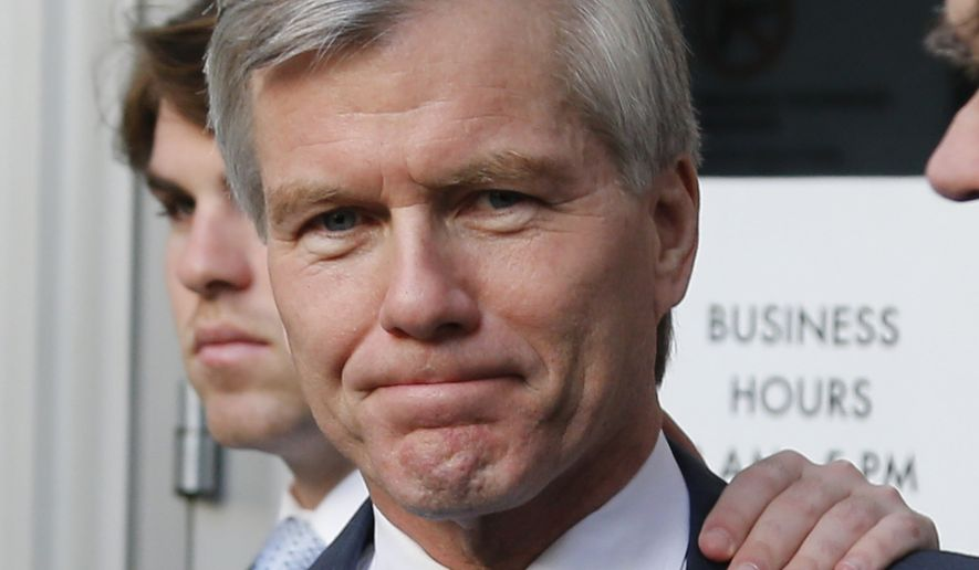 Former Virginia Gov. Bob McDonnell leaves at Federal Court after the first day of jury deliberations in his corruption trial in Richmond, Va., Tuesday, Sept. 2, 2014. (AP Photo/Steve Helber)
