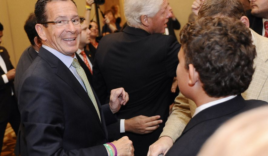 Connecticut Gov. Dannel P. Malloy, left, smiles as he shakes hands with supporters with former President Bill Clinton, center, during a rally in support for Malloy's re-election, Tuesday, Sept. 2, 2014, in New Haven, Conn.  (AP Photo/Jessica Hill)