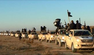 FILE - This file image posted on a militant website on Tuesday, Jan. 7, 2014, which is consistent with AP reporting, shows a convoy of vehicles and fighters from the al-Qaida linked Islamic State of Iraq and the Levant (ISIL) fighters in Iraq's Anbar Province. The Islamic State group holds roughly a third of Iraq and Syria, including several strategically important cities like Fallujah and Mosul in Iraq and Raqqa in Syria. It rules over a population of several million people with its strict interpretation of Islamic law. (AP Photo via militant website, File)