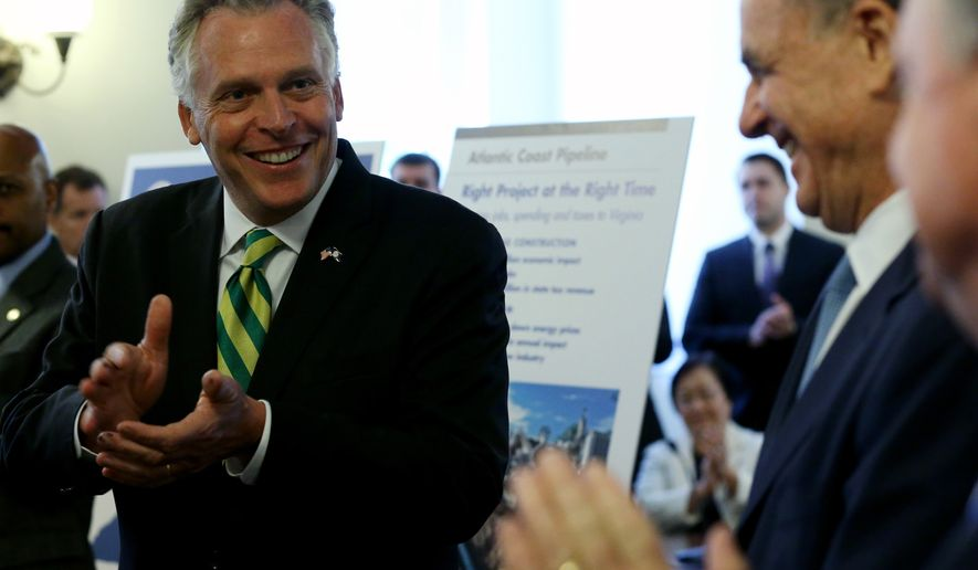Virginia Gov. Terry McAuliffe,left, leads applause during an announcement at the State Capitol in Richmond, Va., Tuesday, Sept. 2, 2014, of a major gas pipeline through parts of Virginia, West Virginia and North Carolina. He was accompanied by  Virginia Natural Gas Chairman Hank Linginfelter, partially hidden, right, and Dominion Resources CEO Tom Farrell, second from right.  (AP Photo/Richmond Times-Dispatch, Bob Brown)