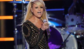"""FILE - In this June 4, 2014 file photo, Miranda Lambert performs on stage at the CMT Music Awards at Bridgestone Arena in Nashville, Tenn. Nominees for the 2014 Country Music Association Awards are announced Wednesday morning, Sept. 3, 2014, on """"Good Morning America"""" and at a news conference in New York. Lambert tops the list of nominees with nine nominations. (Photo by Wade Payne/Invision/AP, file)"""